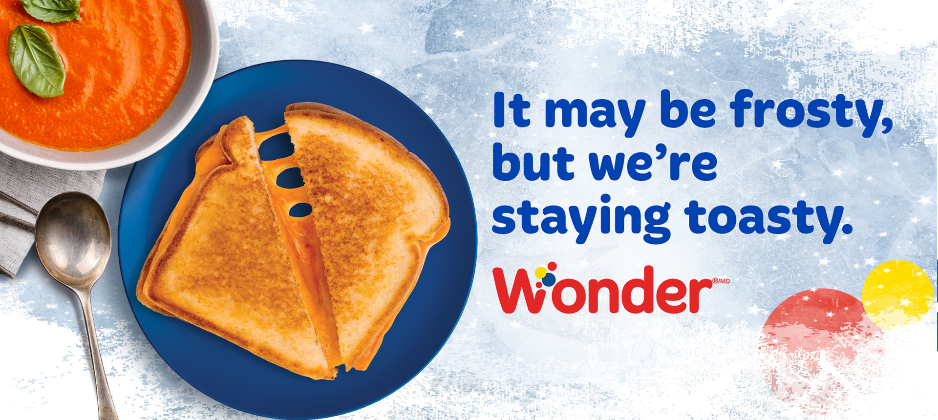 "Image that reads ""It may be frosty, but we're staying toasty"" with a grilled cheese sandwich and tomato soup on ice"