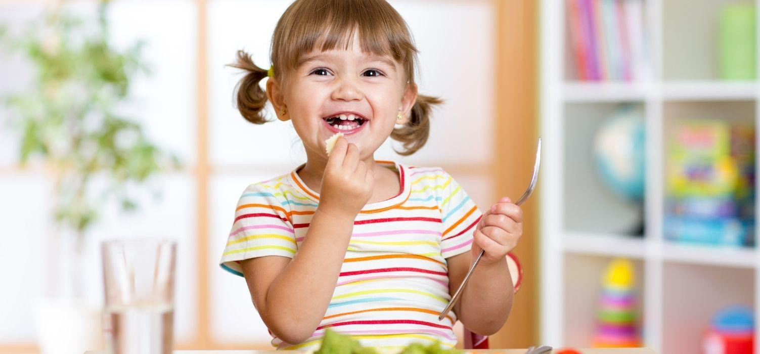 6 Ways To Help Serve Healthy Kids Lunches Blog Image Header - Young Child Enjoying Veggies