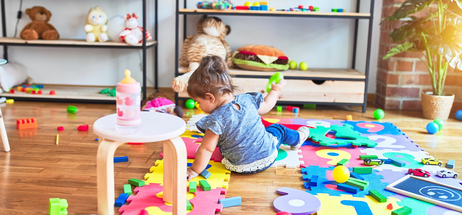 Wonder Bread Blog Organization Tips - Young Child sitting on floor surrounded by toys